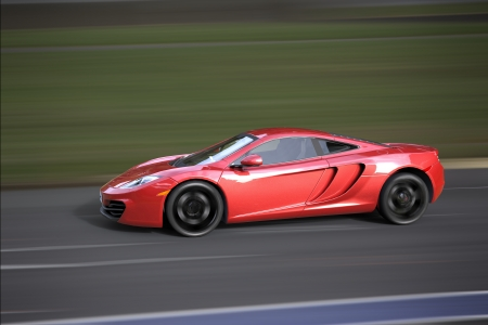 Fast car running at high speed on a track photo