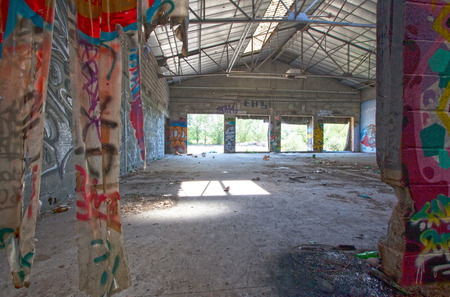 Very damaged abandonned industrial place with many graffitis Editorial