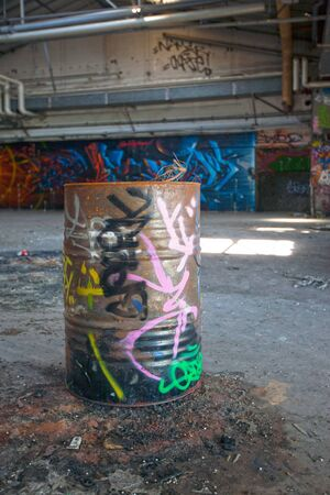 Old tagged barrel in an abandonned indsutrial place
