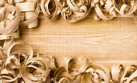 Large wood planer shavings background whit space for text