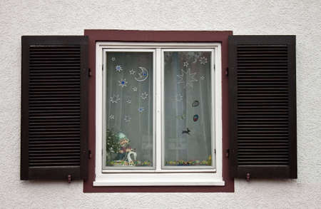 wood blinds: Windows made out in Christmas style.