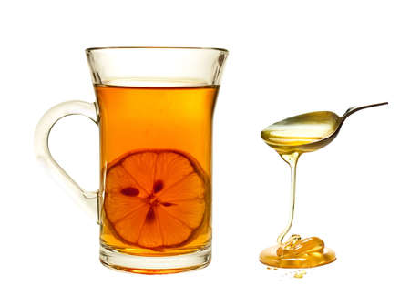 A cup of tea with lemon on a white background. Imagens