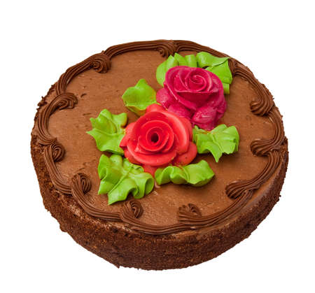 Chocolate cake with two cream-colored roses. Isolated on white background. photo