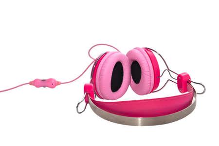Pink headphones isolated on white background. photo