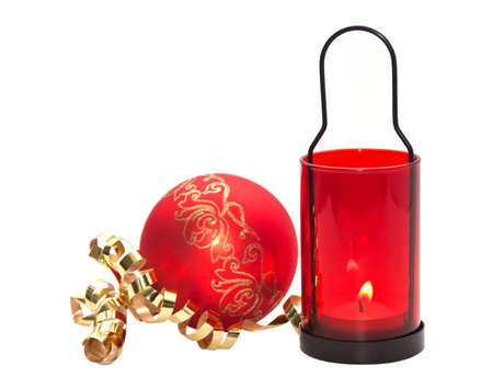 Red candle with Christmas ball isolated on white background. Stock Photo - 8312179