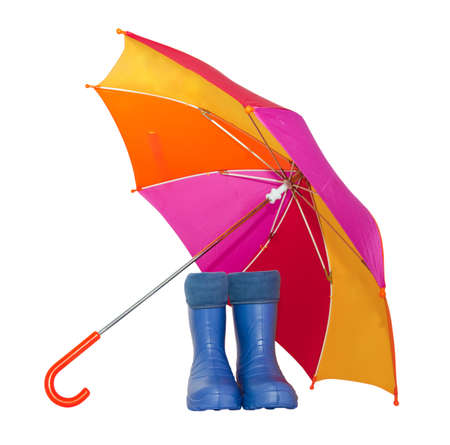 rubber boots and a colorful umbrella isolated on a white background.