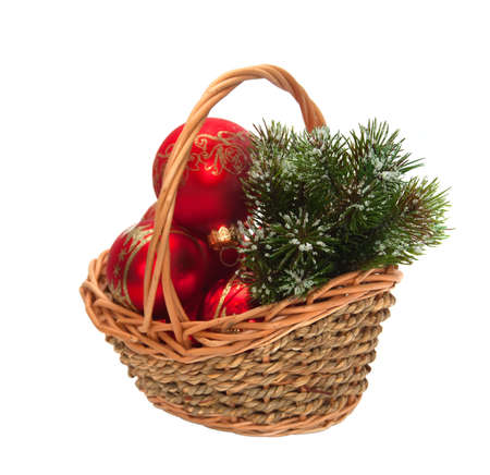 Christmas decorations and a branch of pine in a wicker basket photo
