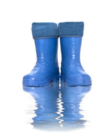 work boots: rubber boots  with reflection in water Stock Photo