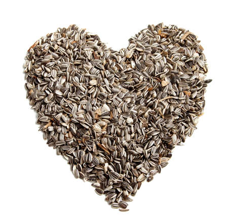 sunflowerseed: sunflower seeds background in the shape of a heart.