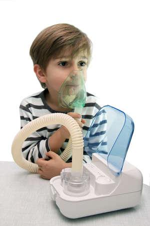 little boy makes inhalation with nebuliser Stock Photo