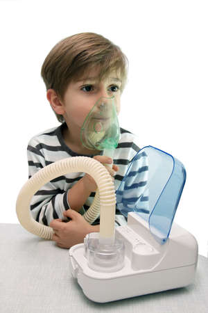 inhalation: little boy makes inhalation with nebuliser Stock Photo