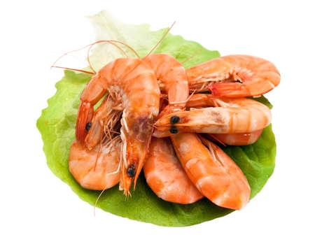 Fresh shrimp on lettuce leaf, isolated on a white background photo