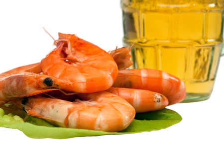 Fresh shrimp on lettuce leaf and a glass of beer isolated on white background photo