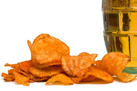 beer and potato chips on white background photo