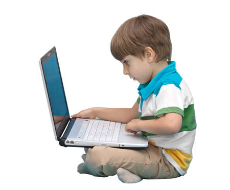 computer learning: Boy with laptop isolated on white background