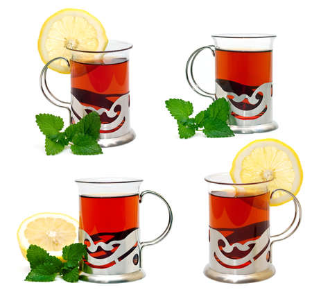 Tea in a glass holder and a sprig of lemon balm photo