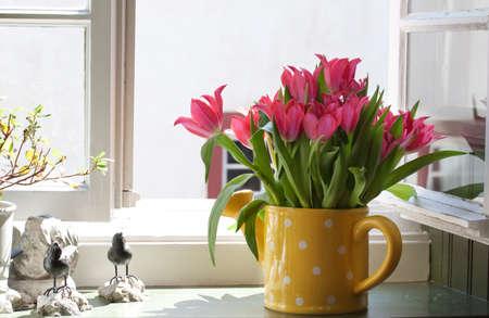 bouquet of tulips on the windowsill photo
