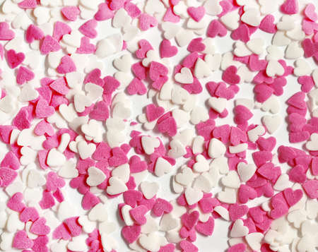 Colorful sweet candy hearts background photo