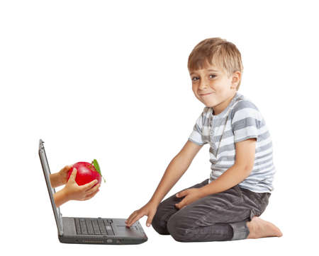 hand with an apple and through the computer screen Stock Photo - 10997256