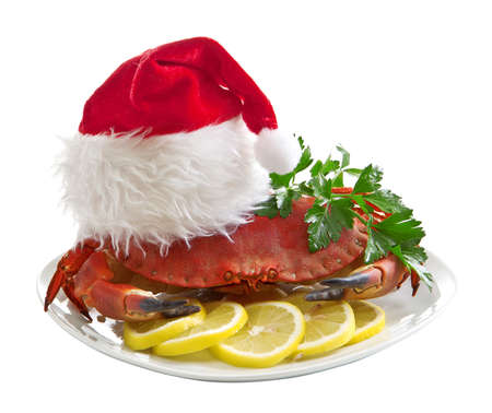 Crab in Santa Claus hat on a platter photo