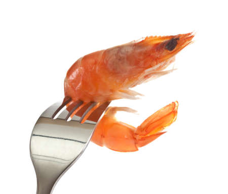 Boiled shrimp on a fork.