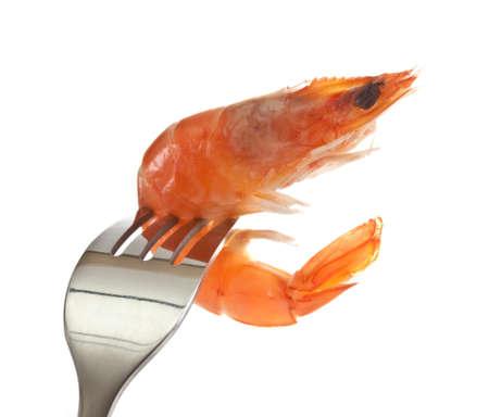Boiled shrimp on a fork.