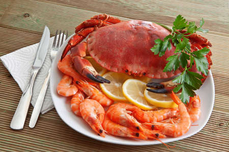 Crab with shrimp and parsley on a wooden table  Stock Photo