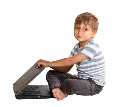 Boy with laptop isolated on white background Stock Photo - 11671711