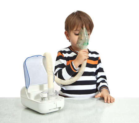 inhalation: little boy makes inhalation with nebuliser
