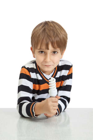 boy holding a lamp, isolated on white background photo