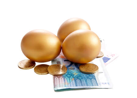 Golden eggs with money bills on white background photo
