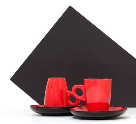Red coffee cups on a black background photo
