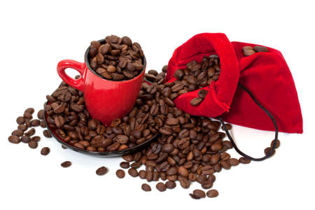 Coffee grains in a bag and in a red cup photo