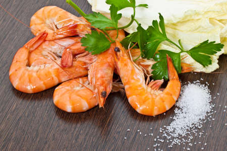 Prawns with a sprig of parsley and salad close up  photo