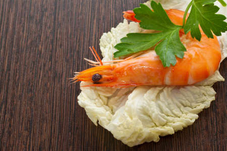 Prawn with a sprig of parsley and salad close up  photo
