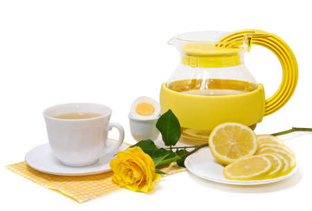 Tea with lemon and yellow roses on a white background photo