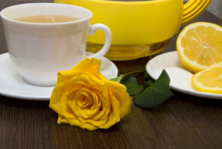Tea with lemon and yellow rose  photo
