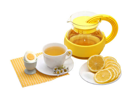 Tea with lemon  on a white background photo