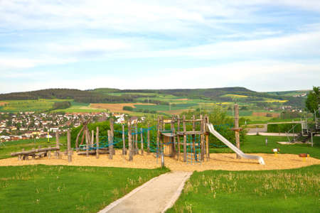 Children's play area outside, against the backdrop of the rural landscape Stock Photo - 13694394