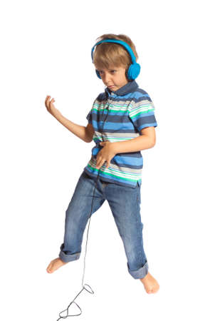 boy playing air guitar and dancing photo