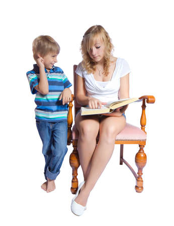 Young woman and boy reading a book. Isolate on white background photo