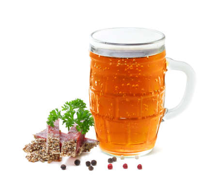 mug of beer and salami with parsley on a white background photo