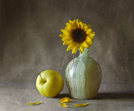 Still life with sunflowers and apples photo