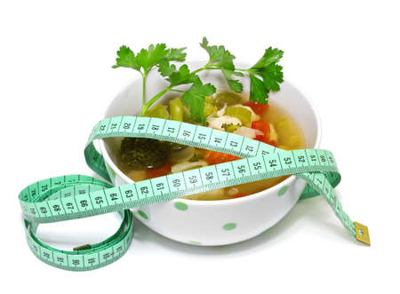 Vegetable soup for weight loss  on a white background photo