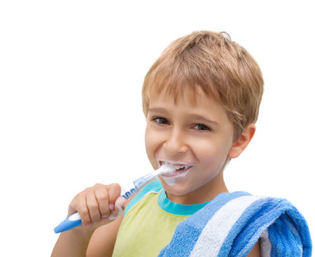 Little boy brushing his teeth photo
