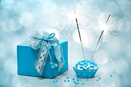 birthday cake with sparkler and  gift