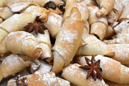 sapid: Freshly baked croissants with powdered sugar  Stock Photo
