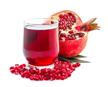 mellow: Ripe pomegranate and glass of juice on a white background