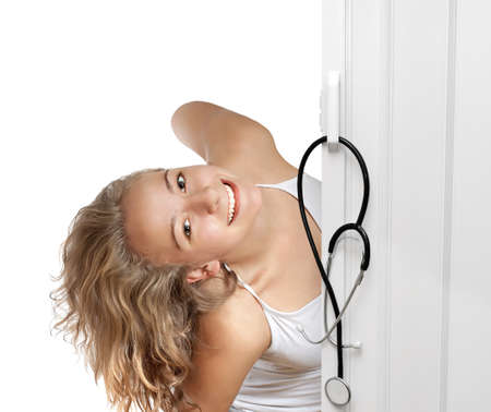 Young woman peeking through door Stock Photo - 18238995