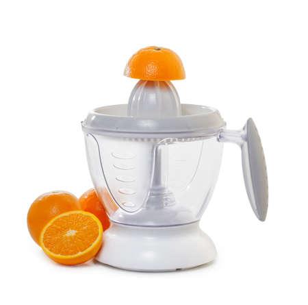 extractor: juice extractor with  ripe oranges  Stock Photo